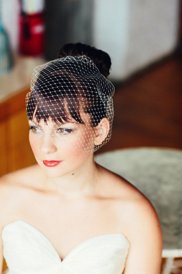 We love a good birdcage veil for a retro look Photography By
