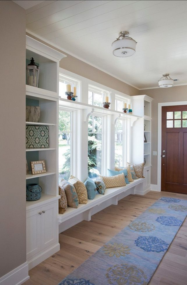 Beach house entryway with white-washed European oak floors and built-in bench