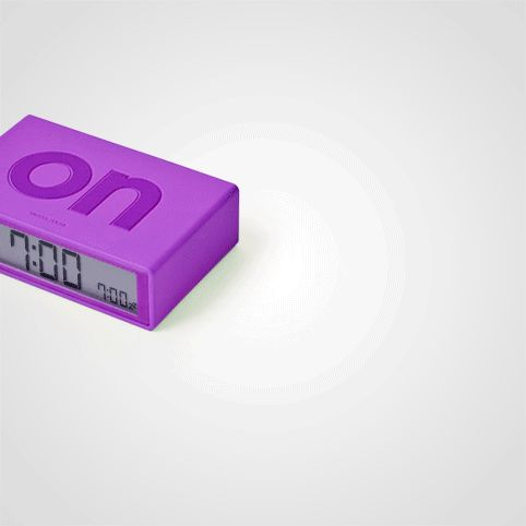 Flip Alarm Clock from Firebox.com. Flipping it over, turns it off.  So easy and cool!