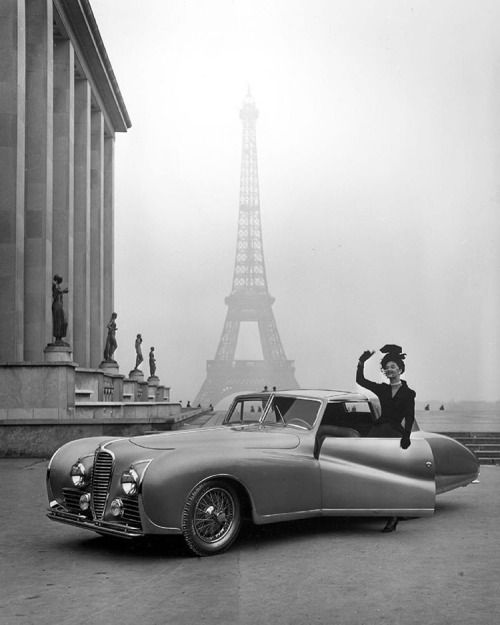 A French model wearing fashion by Jacques Fath posing with a 1947 Delahaye with the Eiffel Tower in the background. (Tony Linck—The LIFE Picture Collection/Getty Images) #fashionfriday