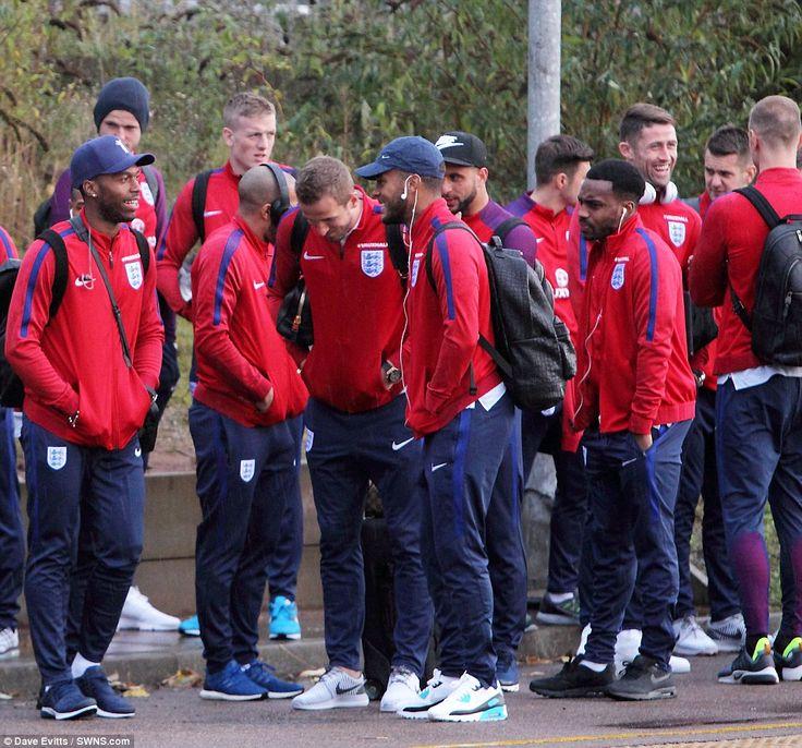 Daniel Sturridge (left) and Ryan Bertrand (centre) share a joke as they await their train...