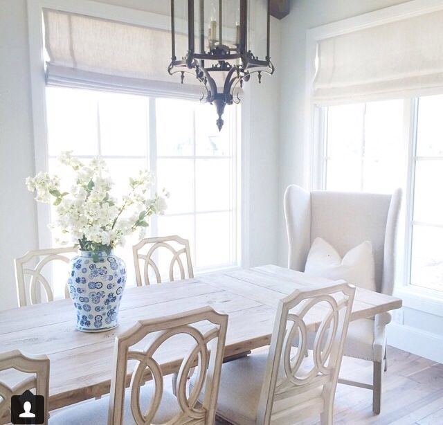 White Dining Space With Asian Lantern