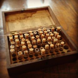 """"""" Mid 19th Century Apothecary case with Contents and Key Here is a rare example of Dr. Pulte's Tinctures with most of the original contents. Several bottles are missing and 2-3 are broken. Still, the contents are largely intact and contain the..."""