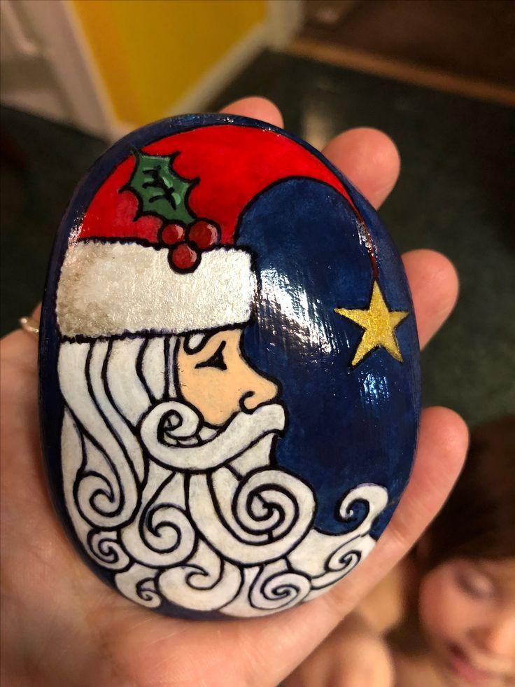 Santa painted rock with metallic star