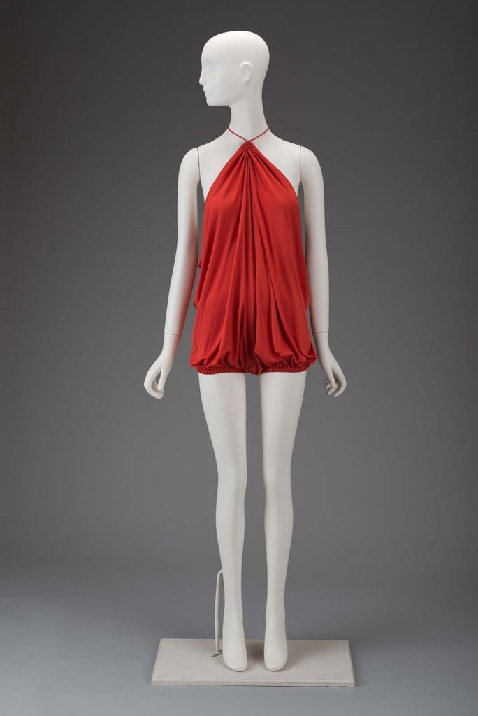 Woman's bathing suit   Gnyuki Torimaru, Japanese, worked in England, born in 1937   England, 1976   Loose tomato red viscose draped jersey swimsuit. Spaghetti string halter. Interior elastic hook and eye waist tie   Museum of Fine Arts, Boston