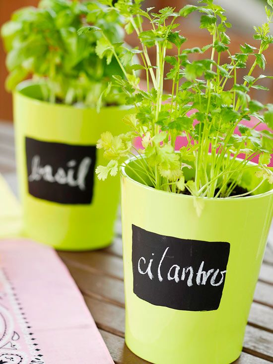 Give pots of herbs an inexpensive label with chalkboard paint! See the rest of this colorful backyard: http://www.bhg.com/home-improvement/porch/outdoor-rooms/colorful-backyard-makeover/?socsrc=bhgpin081512chalkboardpaintpots#page=5