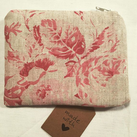 I have for sale a coin purse/zip pouch which I've made using this beautiful linen floral fabric. It's a Cabbages & Roses fabric from the Constance range in raspberry. This is a classic vintage inspired fabric. I have fully lined it in a white cotton fabric and made it generous in