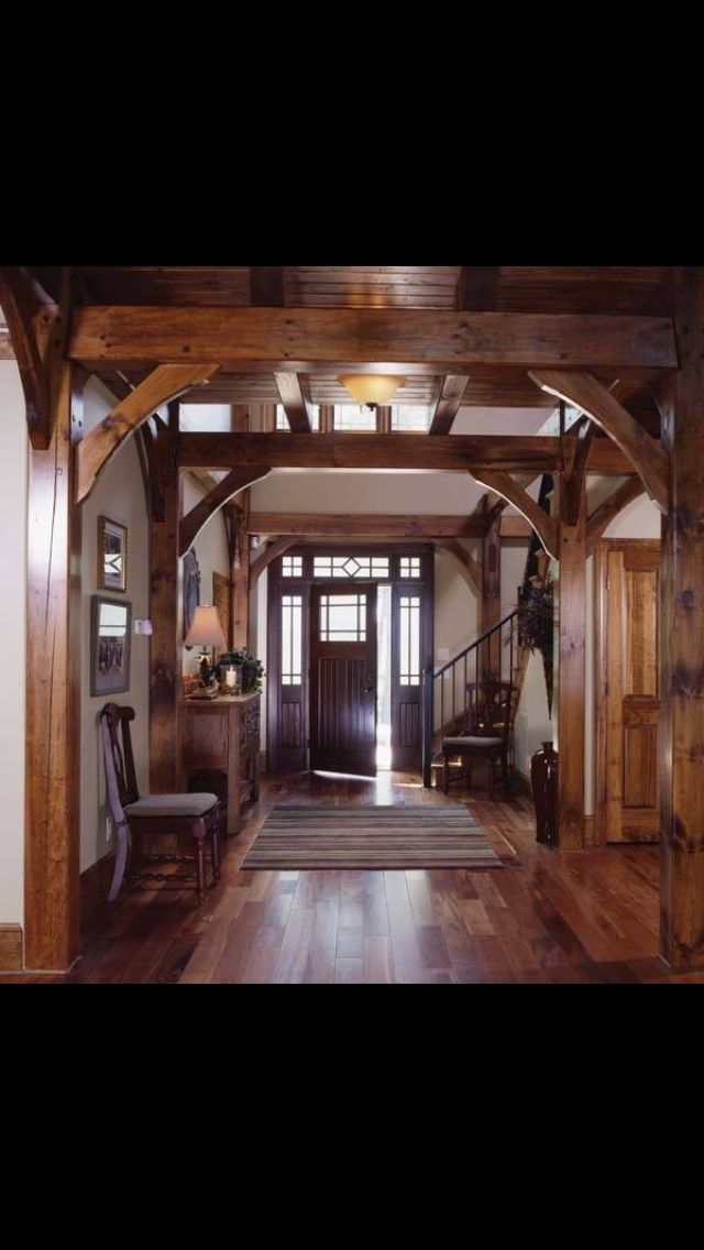 Good The Dark Wood Front Door Matches The Interior Timber Frame Post And Beam  Wood Themed Through Out The Rest Of The Home.