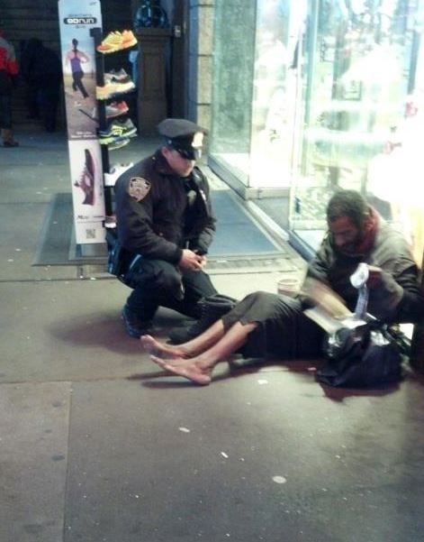 'Tis the season of giving, and at no time was that more apparent than on a street corner in New York City earlier this month.     That's when a tourist witnessed an NYPD officer giving a homeless man without shoes — and with blistered feed — a pair of winter boots. The photo taken of the scene, unbeknown to the officer at the time, has since gone viral.   ~ http://www.theblaze.com/stories/let-this-viral-picture-of-an-nypd-cop-giving-a-homeless-man-winter-boots-restore-your-faith-in-humanity/