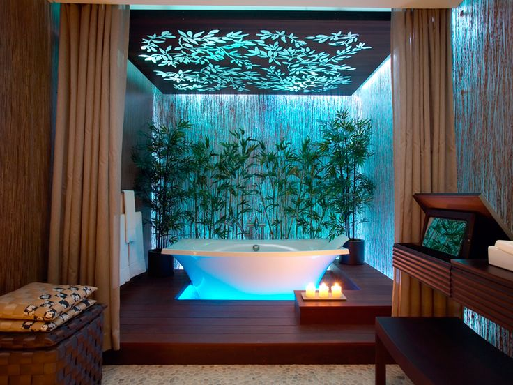Blissful oasis rainforest style bathroom with turquoise for Bamboo bathroom design