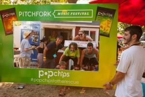 "At the Pitchfork Music Festival in Chicago's Union Park. PopChips sponsored a so-called ""rescue hut."" Supplied by Tuff Shed, the activation was stocked with items that festivalgoers often need, including cell phone chargers. After the festival, PopChips and Habitat for Humanity partnered to donate the hut to the Chicago community."