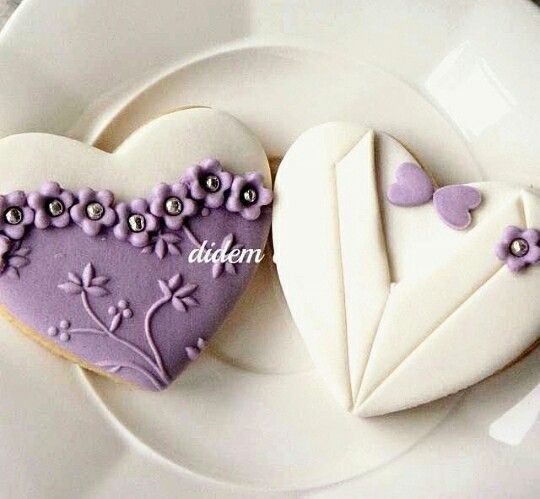Purple and white bride and groom cookies.