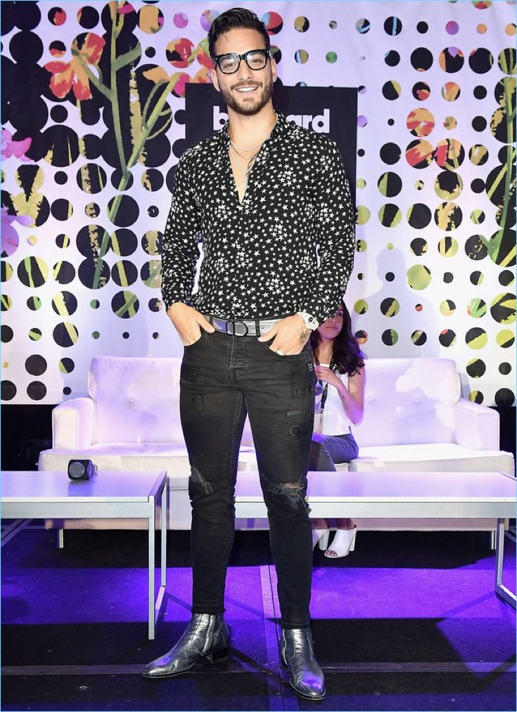 April 2017: Maluma sports a Saint Laurent star print shirt and silver metallic boots for the Billboard Latin Conference.