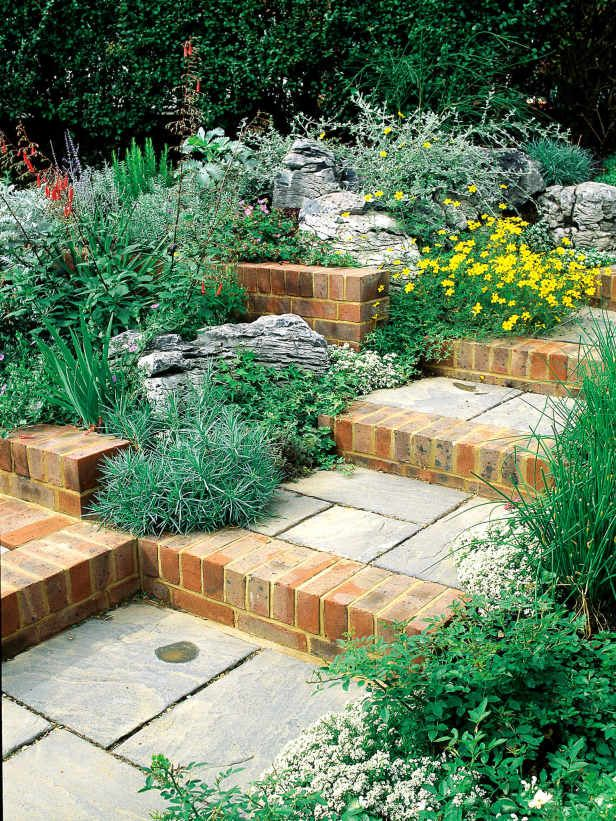 Mix of stone and brick creates rural garden feel a mix of for Mixing brick and stone