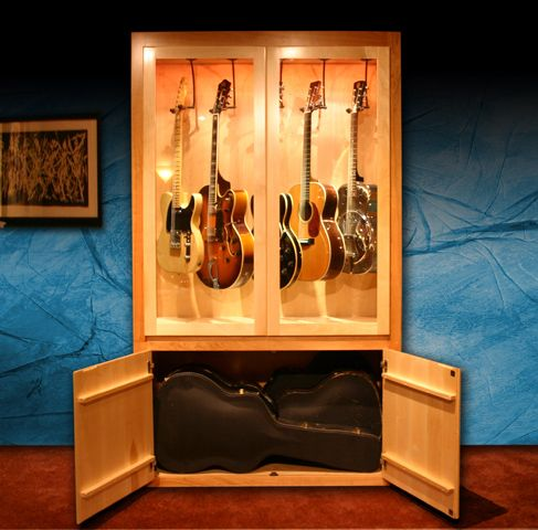 Guitar Collector Showcase... I need to get something like this for my musician hubby! He's always leaving his guitars laying around!