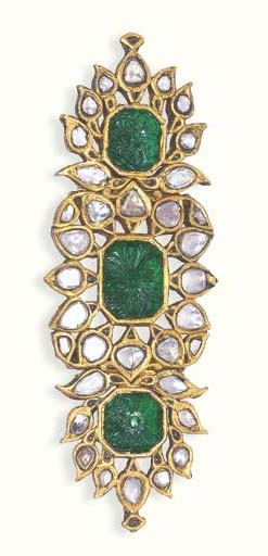 A CARVED EMERALD AND DIAMOND ARM-BAND (BAZUBAND) Each of the three open-work foliate panels centrally set with a carved emerald within a table-cut diamond surround, the reverse decorated with polychrome enamel depicting floral motifs (slight damage to diamond settings and enamel worn in a few areas), North Indian, circa 1800, 12.0 cm. wide