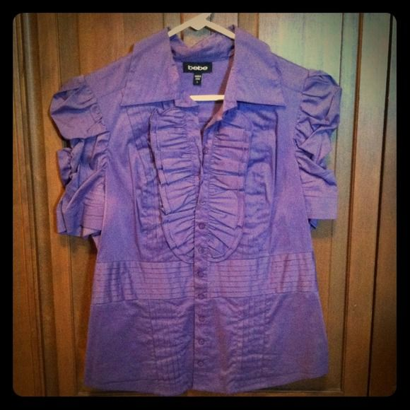 Deep purple collared ruffle shirt Fitted and very flattery bebe button up ruffle top. Very very cute predict for work or a sexy night out. Worn once to a wedding. Can post if like. Love the top but doesn't fit. I had it special ordered in from the Chicago bebe store. bebe Tops