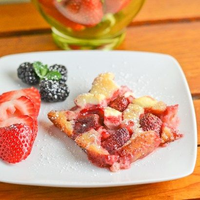 In this strawberry cream cheese cobbler recipe, the strawberries and pieces of cream cheese were laid on a bed of dough and then baked until the dough was cooked.