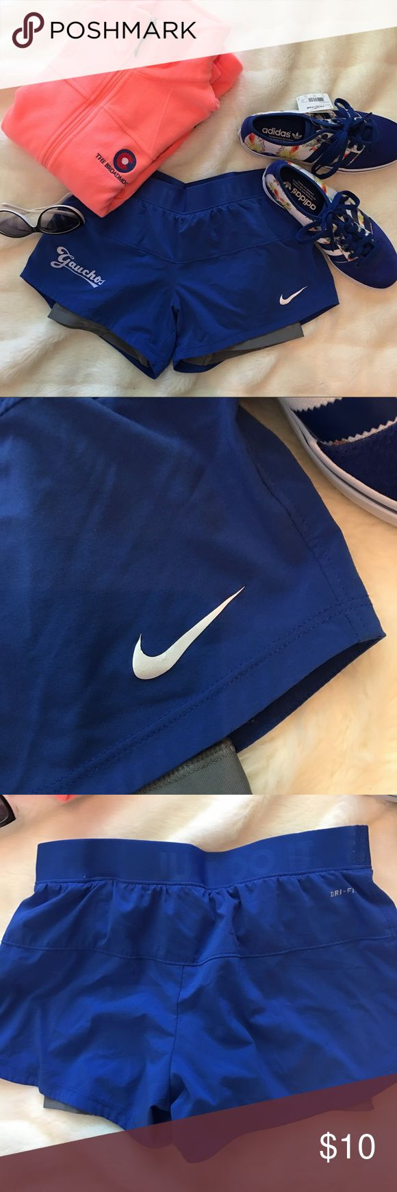 Nike Athletic Shorts Royal blue athletic shorts with attached spandex shorts inside. Adult size small. Nike Shorts