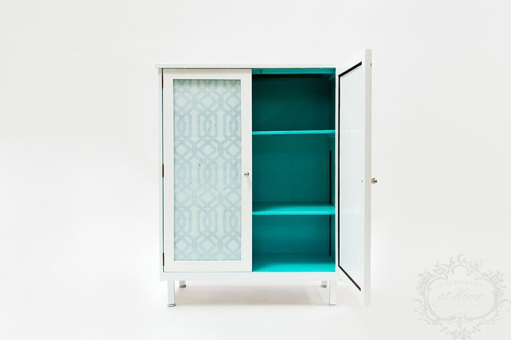This cute little cabinet was rescued and restored with Amy Howard at Home Furniture Lacquer! The outside was painted using White Perfection and the inside was coated with Belize. The glass doors were the perfect platform to use use my lacquered glass technique. I absolutely love how this piece turned out!  #AmyHowardAtHome #CraftingABeautifulLife #Lacquer