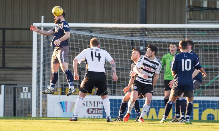 Queen's Park's Bryan Wharton heads clear during the Scottish Cup round 4 game between Ayr United and Queen's Park.