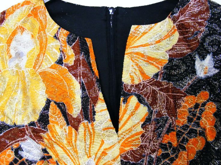 Detail of a 1960s psychedelic lurex flower power dress