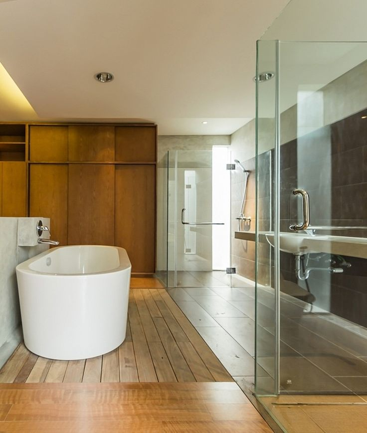 Wonderful Amusing Bathroom Design In Lumber Shapedbox House By Atelier Riri With An  Oval Bathtub On Wooden Floor Add With Glass Room Separator, Photo Gallery
