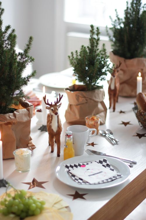 Small trees in paper bags - although they would interfere with conversation as table decorations