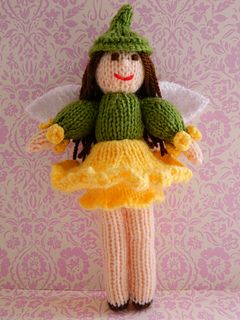 This is a Daffodil Fairy. The knitted doll 21cms tall. This knitting pattern is worked flat and would suit a Beginner. http://www.ravelry.com/patterns/library/daffodil-fairy-doll