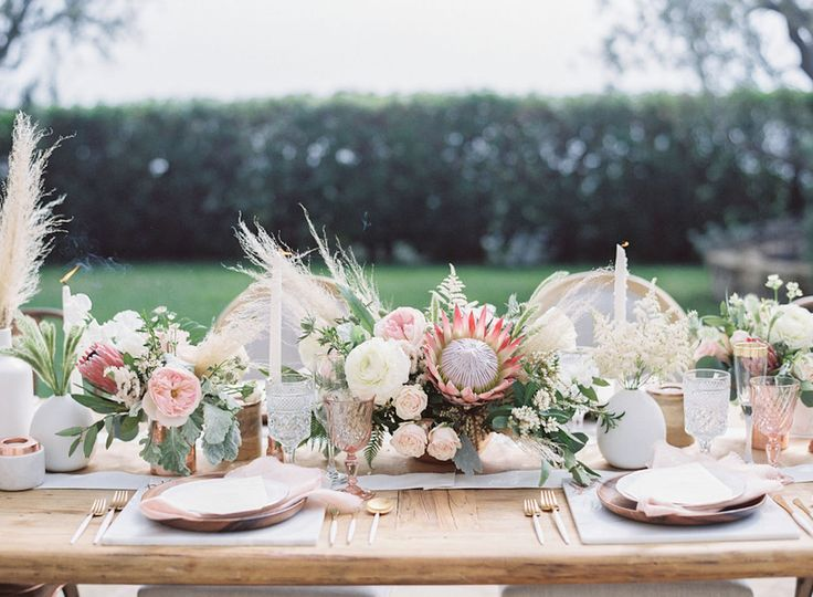 protea centerpiece with blush pink and white accents