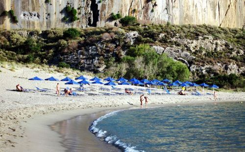 Plakias Beach in Crete is a crescent form beach with a small harbor
