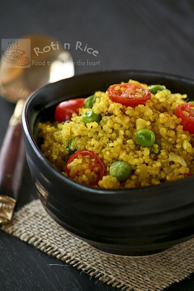 Turmeric Spiced Quinoa, lightly pan fried with spices and mixed with green peas and grape tomatoes. Deliciously nutty and flavorful!