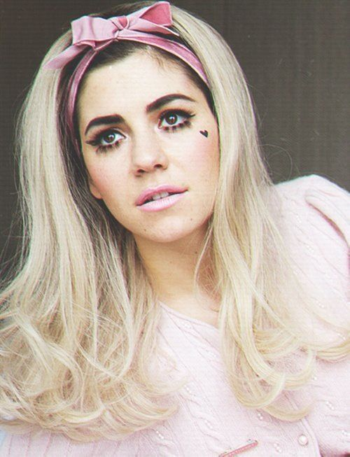 Marina and The Diamonds -  pink bow in her hair and heart on her cheek ( never on her sleeve ) <3