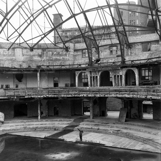 An American soldier, PFC Douglas Page, offers a mocking Nazi salute inside the bombed-out ruins of the Berliner Sportspalast, or Sport Palace. The venue, destroyed during an Allied bombing raid in January 1944, was where the Third Reich often held political rallies.