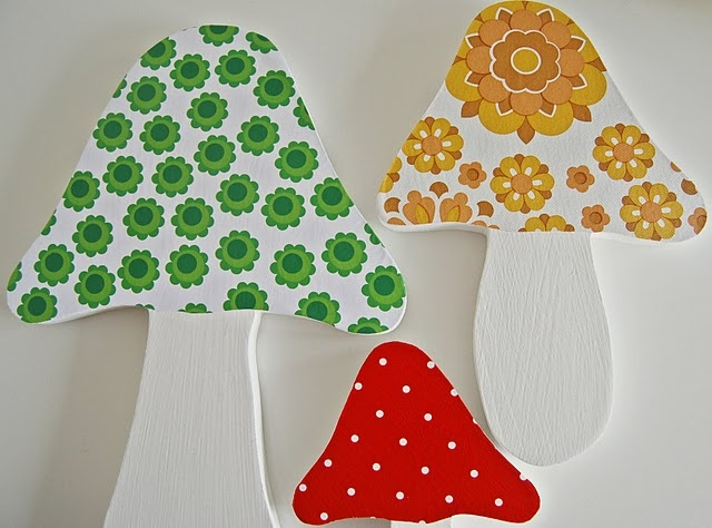 Cute wall decorations.  One could really make these using foam board and scrap book paper or scrap fabric.