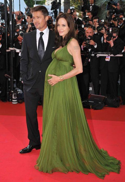 Few celebrities have mastered red carpet maternity style quite like Angelina Jolie. The actress was the picture of elegance in a flowing olive-colored gown in Cannes.