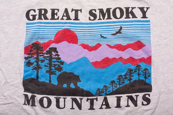 For sale here is a vintage early 90s Great Smoky Mountains t-shirt with great retro nature graphics; made in USA. It is in good vintage used condition with some wear and pilling, some discoloring and waving on the collar edge, a couple pinholes on the bottom seam and a little very faint staining. This vintage Great Smoky Mountains t-shirt would be a great gift for the nature lover!  Brand: Smoky Mtn. Ts  Era: Vintage early 90s  Tag Size: Adult vintage XL – Use measurements to ensure proper…
