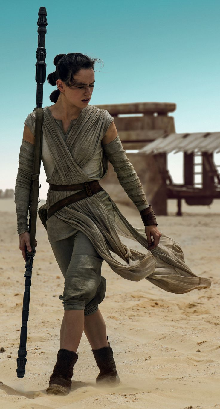 High-Res Rey. Good look at collar; Wrap is sewn into pleats along shoulder; Black ties used in the hair; sort of rough way of joining seams (seen at sleeves and side seams)