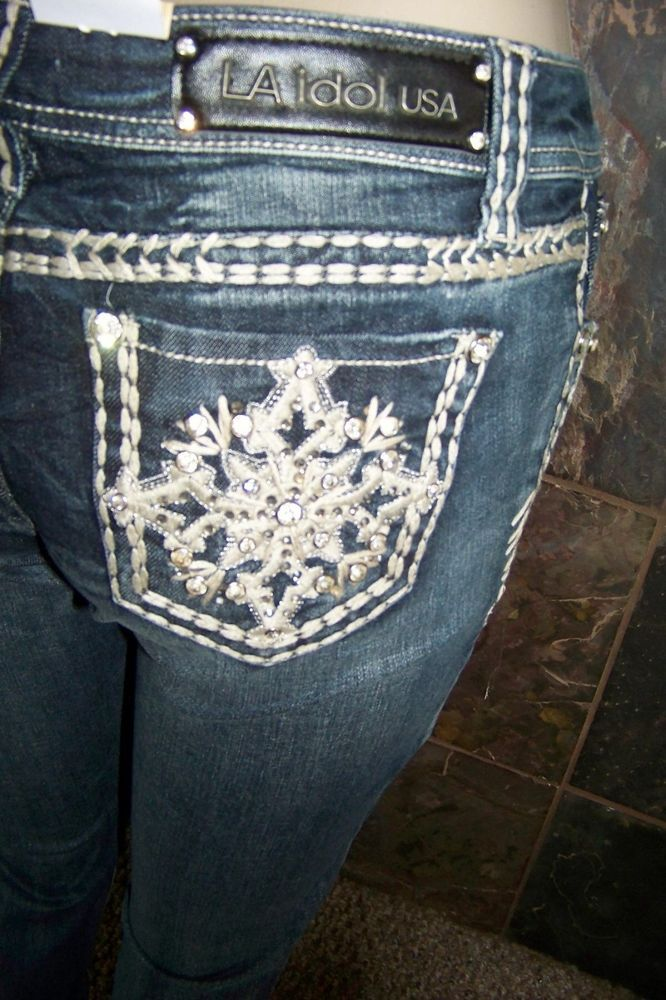 Distressed embellished bootcut jeans