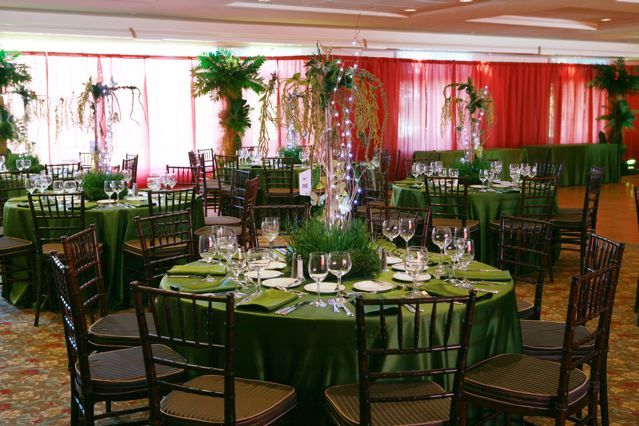 Rainforest theme Bar Mitzvah with jungle centerpieces and fake jungle trees by The Prop Factory, via Flickr