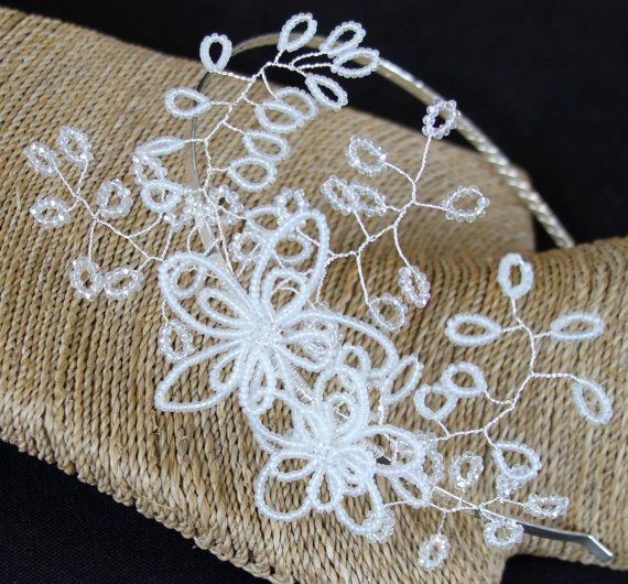 Delicate, vintage style worn to the side...  Extending out quite a distance from the silver coloured tiara band is this gorgeous headband.