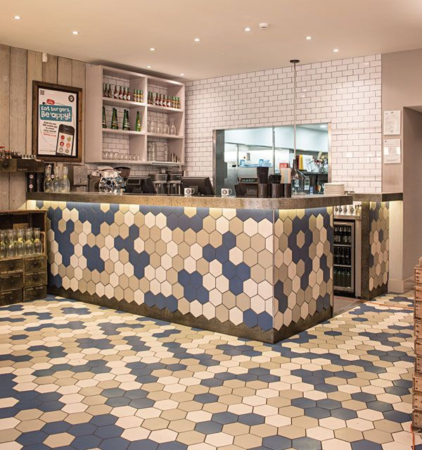The quirky and chic restaurant features tiles from our hexagon shaped Honeycomb range which is one of our most unusual and exciting products.  Named after the complex hexagon patterns found in natural honeycomb, this range can be laid in infinite patterns on both floors and walls.