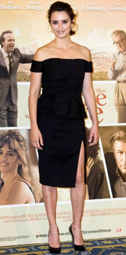 Look of the Day › April 13, 2012 WHAT SHE WORE At a press event for To Rome with Love, Penelope Cruz looked simply stunning in an off-the-shoulder Emilio Pucci LBD and sky-high Casadei stilettos. WHY WE LOVE IT The beautiful actress worked the sexy silhouette of her not-so-basic black design