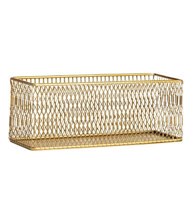 Gold-colored. Storage basket in metal with mesh sides. Size 3 1/2 x 3 1/2 x 9 1/2 in.