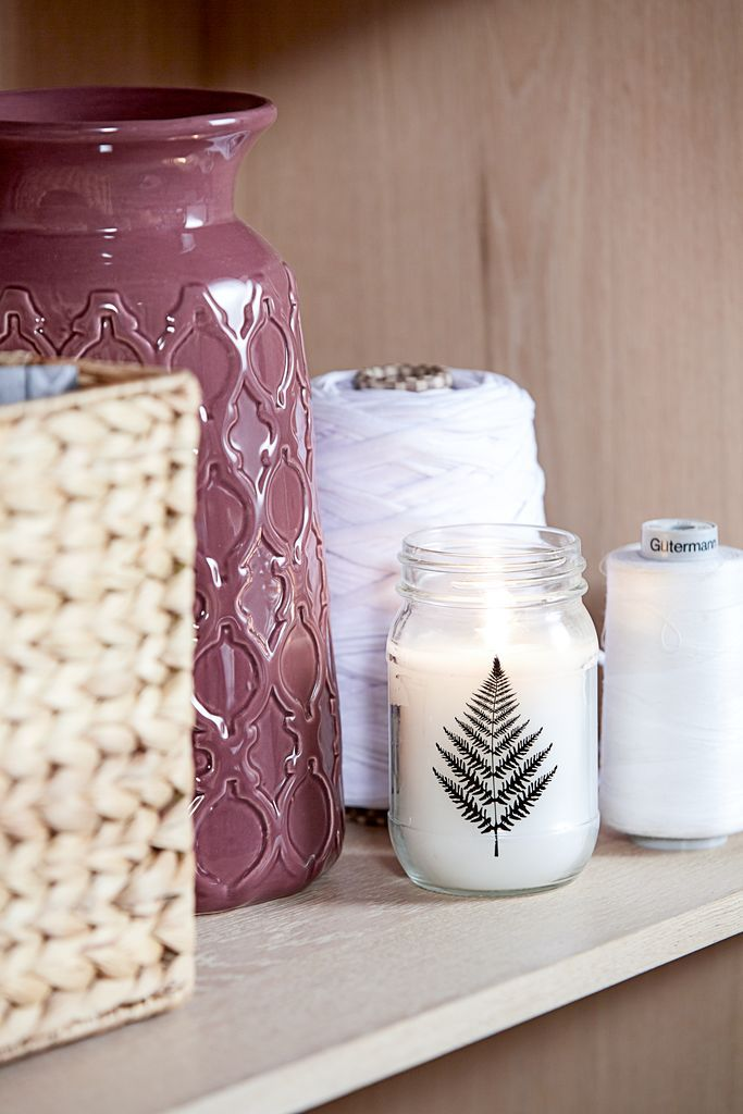 A fragrant candle grouped together with beautiful vases. So much Hygge!