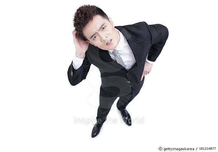 Young businessman showing a confused look - gettyimageskorea
