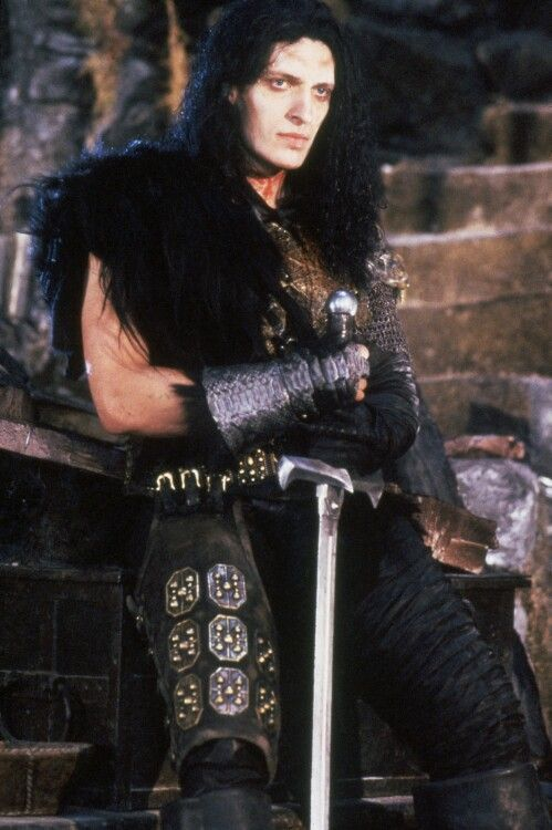 Clancy Brown as the Kurgan in Highlander. Another one for height and character.