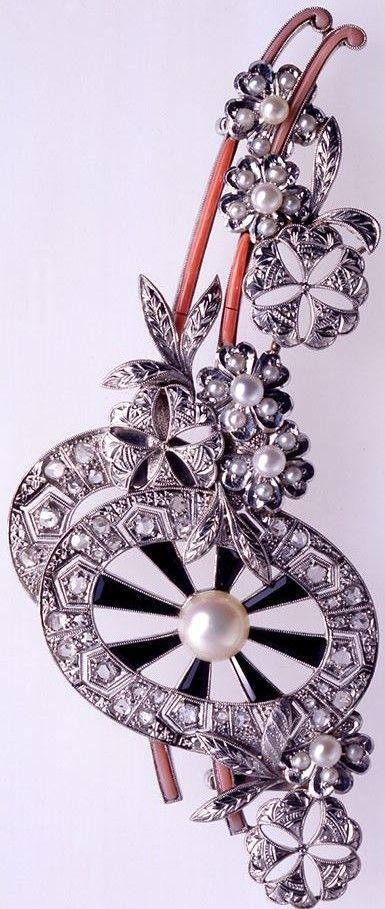 Mikimoto Sash Clip Hanaguruma circa 1910 set with onyx, diamonds, pearls and coral.