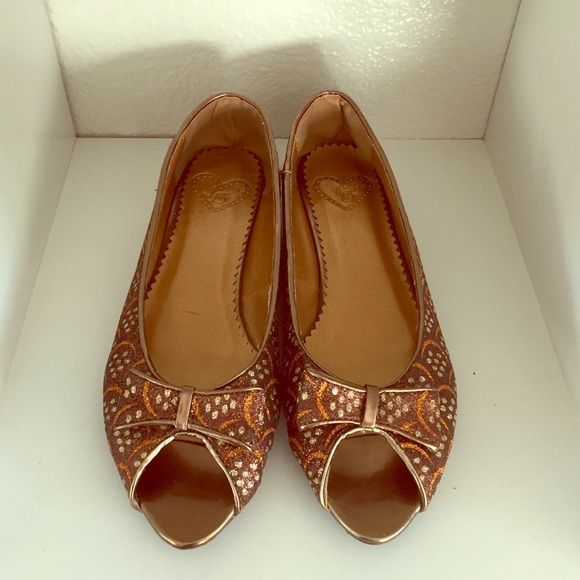 Size 7 Brown & Gold Peep Toe flats. Brand New! Size 7 Brown & Gold Peep Toe flats. Brand New! Never worn. Perfect for the holidays. Love D Shoes Flats & Loafers