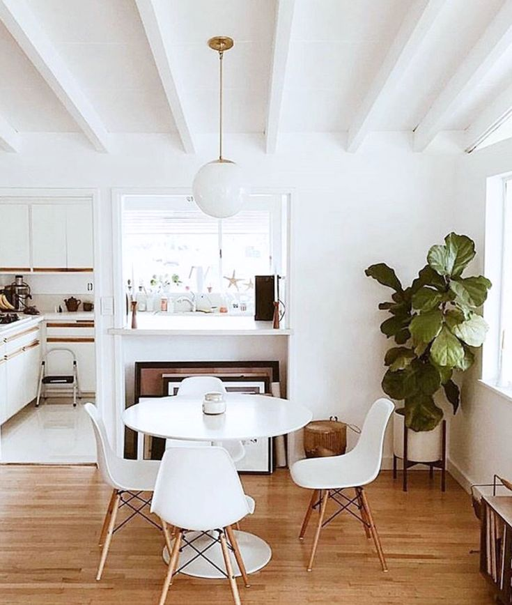 painted white beamed ceiling in dining room
